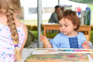 Children having fun at The Willow School Activity Tent